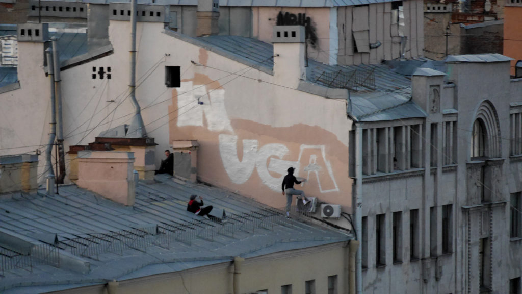 Some local artists over the roofs of St. Petersburg