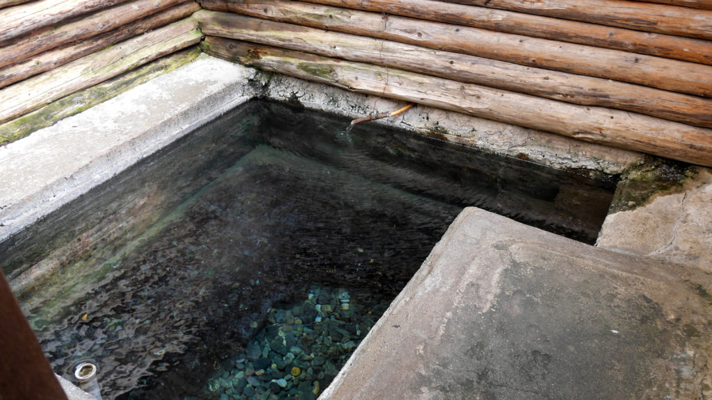 The pool was made out of concrete with stones on the bottom