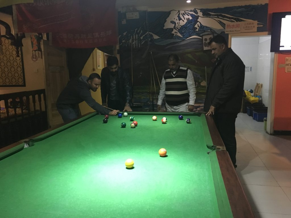 Playing pool at the hostel (and sucking at it)