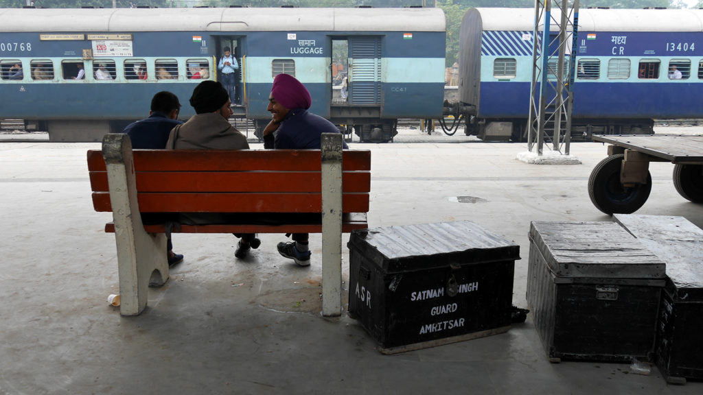 Sikh boys waiting for their train