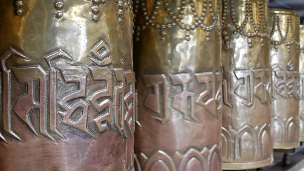 There are prayer wheels all around