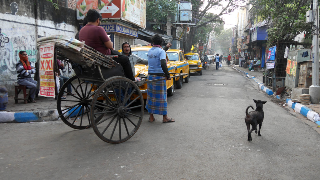 The other end of Sudder Street and typical transportation in Kolkata