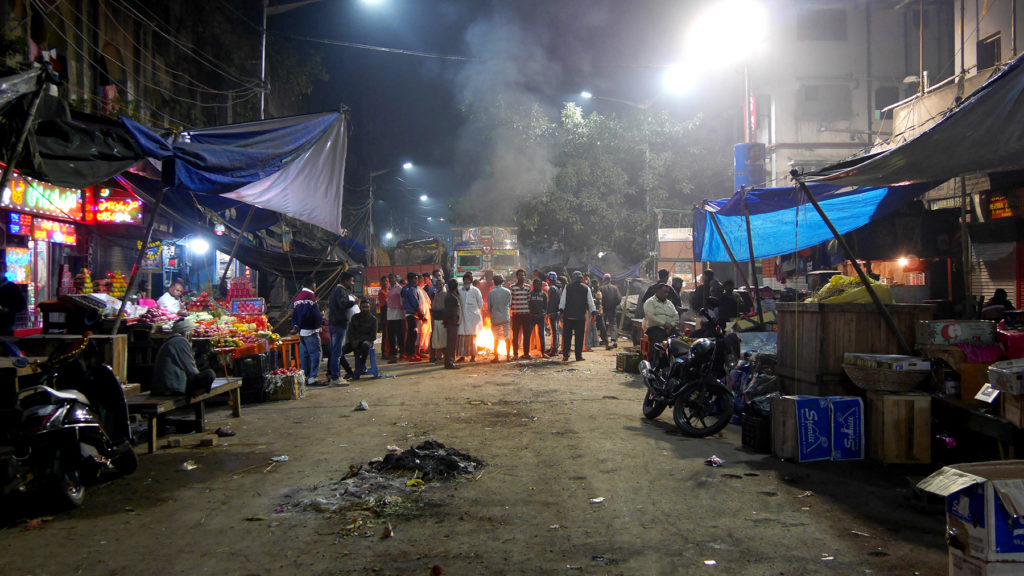People gathered around the fire at Bara Bazar