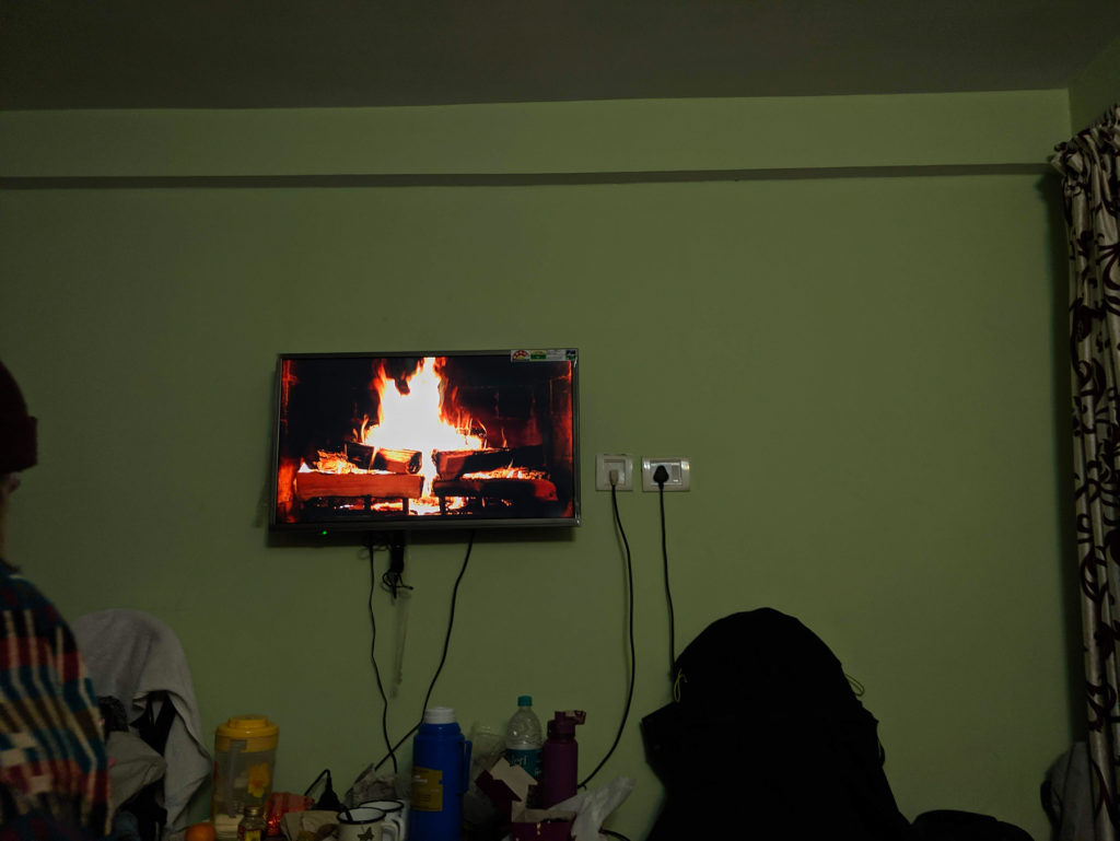 We put this fireplace video on to get some cozy feeling and placebo heating for our room