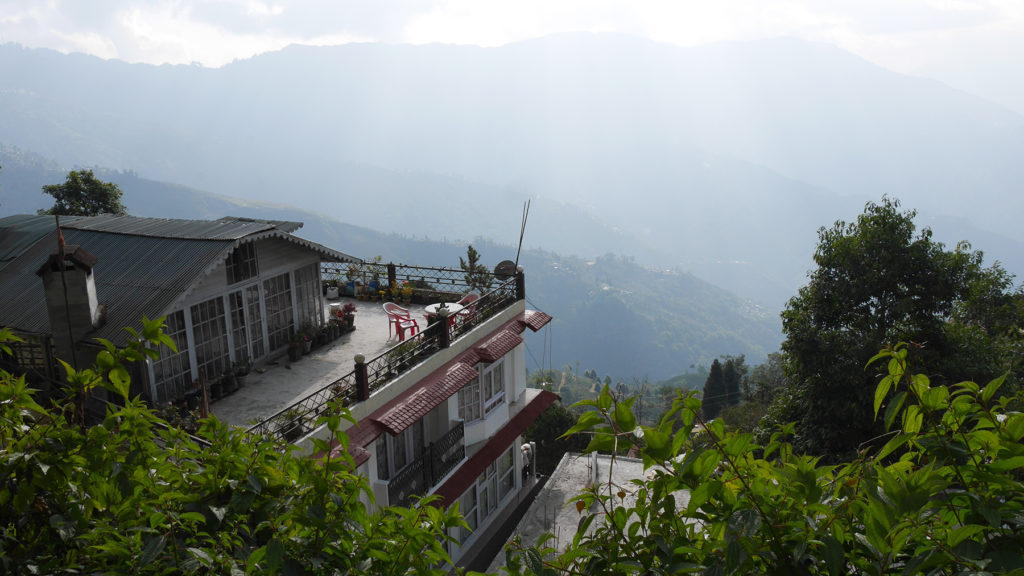 Teesta Homestay. Our balcony was that one in the middle under the roof terrace