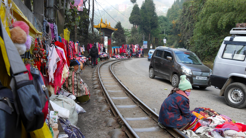 A little market along the narrow train track in Ghoom