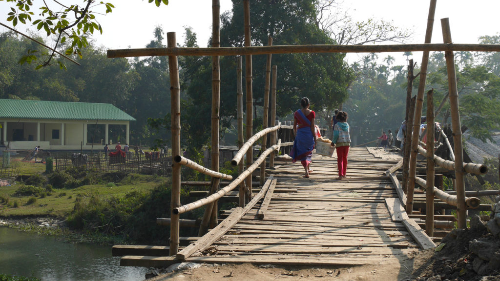 Girls crossing a bridge