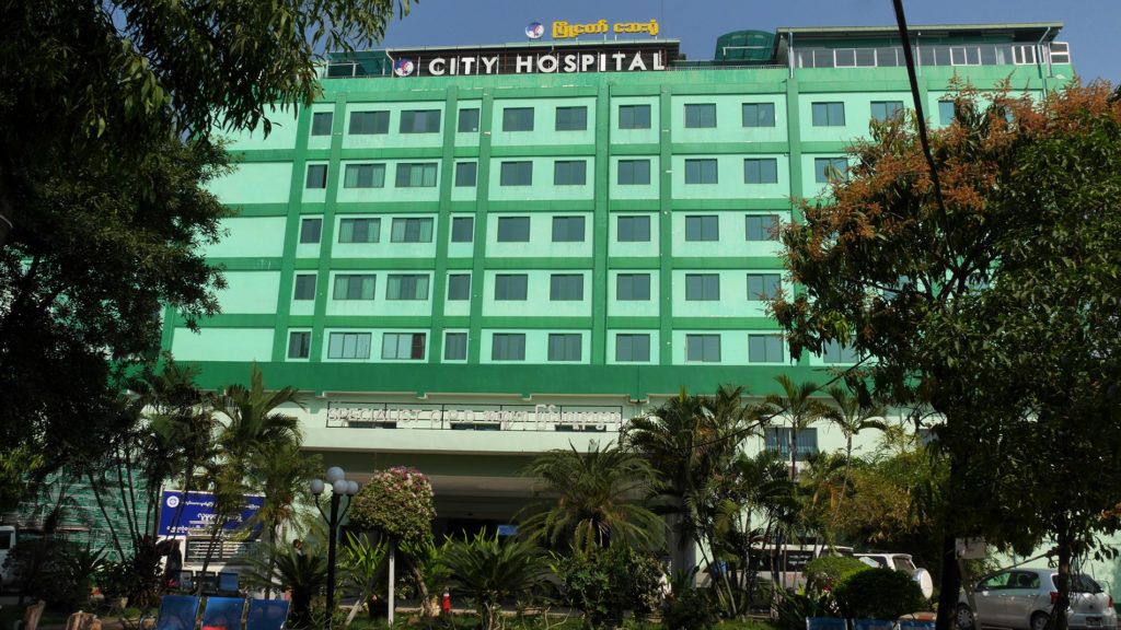 The Mandalay City Hospital seems to be an okay place to go if you need help in English