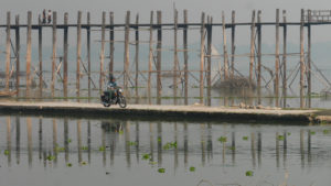 Seri riding motorbike next to the U Bein Bridge