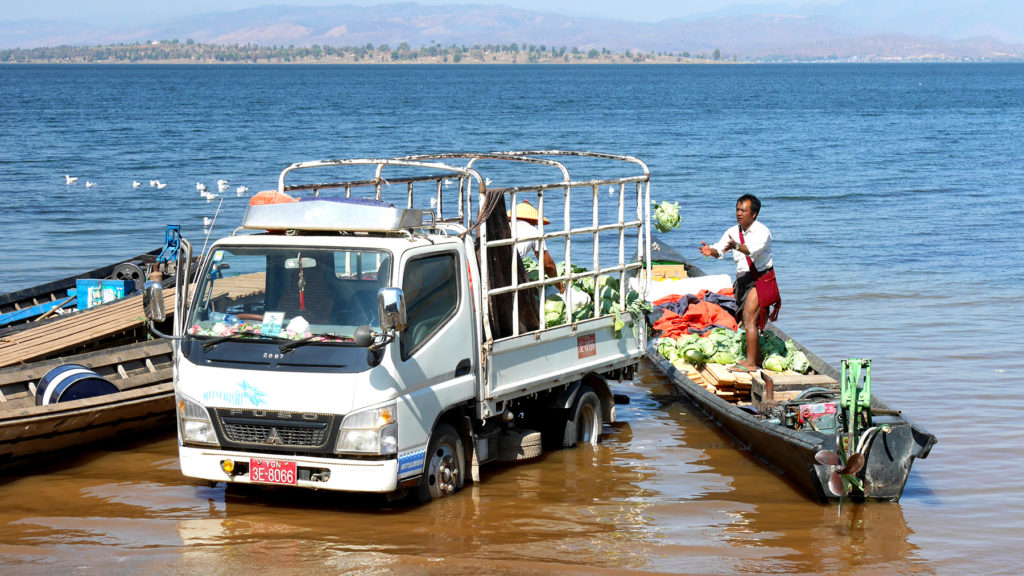 Loading vegetables from a truck to a boat was entertaining to watch while eating